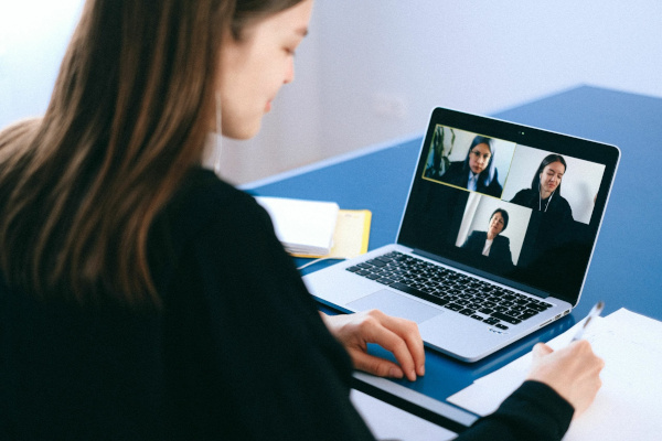 Woman on laptop video conference