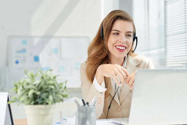 Woman on phone with headset